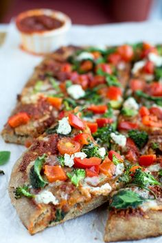 This Veggie Sun Dried Tomato Pesto Pizza is about to be your new favorite pizza. The base is an amazing sun dried tomato pesto and it's topped with lots of yummy veggies like pepper, broccoli, and tomatoes. And, of course, mozzarella and goat cheese.