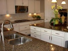 Kitchen Remodeling Countertops Among the hottest trends in home style today is rock kitchen counter tops. These sturdy, heat-resistant, elegant counters are a lovely and also sensible enhancement to any type of house. White Cabinets White Countertops, Brown Granite Countertops, Brown Cabinets, White Kitchen Cabinets, Painting Kitchen Cabinets, Kitchen Redo, New Kitchen, Dark Granite Kitchen, Kitchen Backsplash