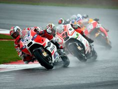Italian rider Andrea Dovizioso, left, of Ducati leads during the MotoGP race of the British Motorcycling Grand Prix at Silverstone race track, Northamptonshire, Britain.   Tim Keeton, EPA