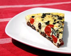 No-Bake Veggie Frittata: Made with cherry tomatoes, cubes of mozzarella cheese, black beans, and purple basil, a high-protein piece of this veggie frittata is bursting with flavor. Pair your under-200-calorie piece with whole-wheat toast or a side salad for the perfect breakfast, lunch, or even dinner.