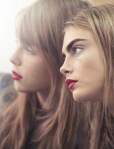 Models Cara Delevingne and Edie Campbell wearing the Siren Red runway look from Burberry Beauty