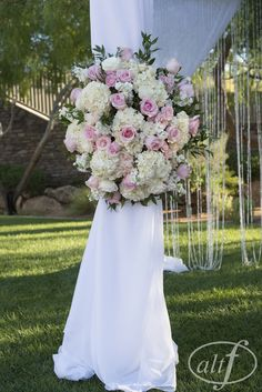 Enchanted Florist Las Vegas- Full, lush arch flowers in pastel pink, peach and ivory.