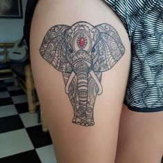 Traditional mandala elephant tattoo on the hip