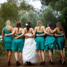 Cute!! With the whole wedding party walking down a fairway.. also a shot of us walking so you can see the front of us...
