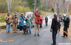 2014-11-01 Ribbon Cutting, photographed this morning by Walter Barnard at an impromptu ceremony by local residents celebrating the completion of the Kelly's Cove Bridge on Shore Road.  The ribbon-cutter is Paul Mazur, who lives adjacent to the bridge.