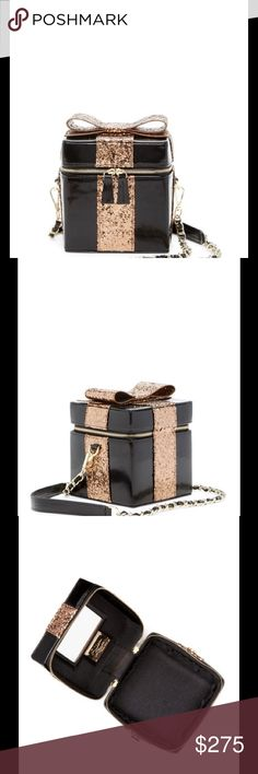 """⚡️SALE⚡️ Alice + Olivia Present Box evening bag - Detachable drop-in chain shoulder strap  - Zip top closure  - Leather construction  - Exterior features glittery blow applique  - Interior features 4 slip wall pockets and tacked mirror on lid  - Dust bag included  - Approx. 5.5"""" H x 5"""" W x 5.5"""" D  - Approx. 22"""" strap drop  - Imported  Materials Leather exterior, textile lining  Brand new with tag. Retail price $395. Alice + Olivia Bags"""