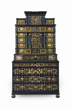 A South German ormolu-mounted ebony, ebonized, and pietra dure cabinet, 18th/19th century.