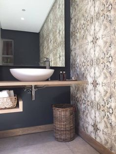 Simbithi Eco Estate: This beautiful, modern little bathroom by Margaret Berichon Design was given it's edge thanks to the #wallpaper and colour scheme chosen.