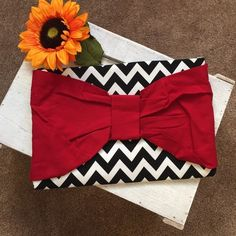 Large Bow Clutch Vintage love, One of a kind!❤️ Brand new. Unused. Handmade. Denim and patterned fabric. Velcro closure. Easily ironed to take out wrinkles. Chevron pattern with a big red bow. So gorgeous! The PERFECT holiday party accessory or gift! I paid 65 plus shipping for it. Open to a good offer!! Bags Clutches & Wristlets