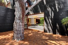 """Sebastian Mariscal's """"Venice House"""" project features an interesting concept in the balancing between the interior and exterior of the house; blurring the lines of indoor and outdoor living. Each section has been nearly integrated into the natural landscape,and no form of nature was compromised during the construction as the existing trees in the plot of …"""