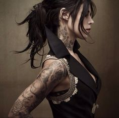roses on the neck and full bloom on the lower arm. Ms. Von. D., please tattoo roses on my life.