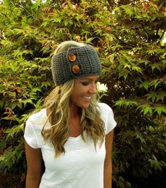 Gray crochet/ knitted headband/ear warmer. Obviously she doesnt need it where ever she's at... it looks warm there... ;]