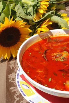 "This tasty Hungarian fish soup recipe is a real delicacy, and it is often served at Christmas. This bright red fish soup, which is known as ""halaszle,"" is made with mixed river fish. It is traditionally made in small kettles over an open fire."