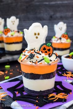 No Bake Halloween Cheesecake Parfaits - layers of no bake cheesecake and Oreo cookies topped with Halloween sprinkles and candies is a fun treat. Make this easy recipe for Halloween parties!