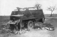 A British armoured car crippled by enemy gunfire with its crew either dead or captured. The Vickers Maxim guns have been disabled and their cartridge belts torn away.