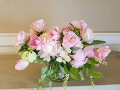 Blush pink arrangement.   Peonies, tulips, roses.  In bloom, ltd.
