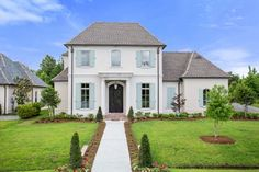 This gorgeous #traditional #HousePlan features the perfect European twist! Click here to view more photographs: http://www.thehousedesigners.com/plan/le-pierre-9627/