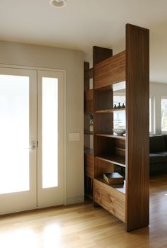 Book Case As A Wall Divider Perfect For The Ranch House Where You Cant Create Foyer