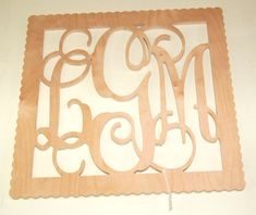 """Square bordered personalized monogram.  Available in scalloped or plain border.  18"""" and up."""