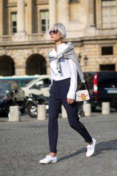 simple easy and chic... White button down shirt plus navy tappered trousers and white sneakers...