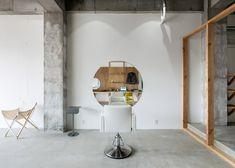 Sides Core adds circular mirrors to a minimal Japanese hair salon.