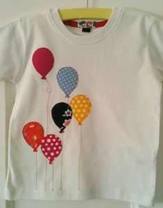 Baby girl Balloon appliqued T-shirt toddler sizes in bright pinks and patterns. £12.00, via Etsy. mycoatofmanycolours