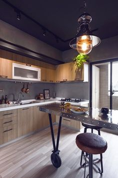 cocina industrial metal y madera techo negro apartamento masculino