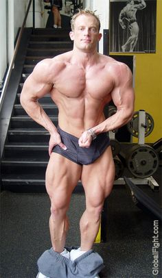 a musclejock posing flexing big flexed muscles man