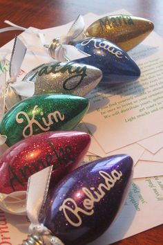 DIY Glitter Christmas Light Bulb Ornaments: 1) Take a little bit of floor wax (pledge floor multi-surface or Mop and Glo) swirl in the ornament, drain excess. 2) Use a funnel to add extra fine glitter, it will stick to the inside of the glass. 3) Shake excess out. 4) Dry upside down for awhile. You can also embellish with ribbon, vinyl etc!