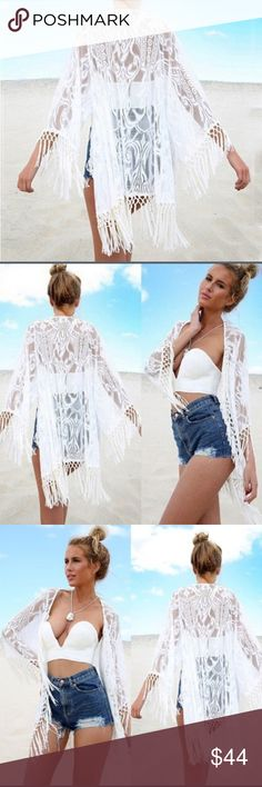 """🎉 White lace Kimono 🎉 White lace with fringe kimono cardigan. Sold silk-like fringe. Size small. Last four photos are the actual item. Back of neckline to bottom of fringe approx 33"""". Hand wash and dry flat. Price firm unless bundled. Tops"""