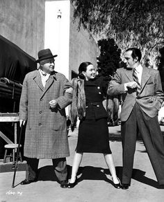 Patricia Morison with Nigel Bruce and Basil Rathbone between scenes of Dressed to Kill 1946.