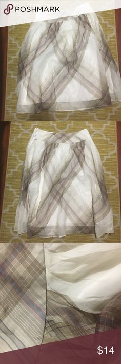 Silk skirt 100% pure silk. A lovely classy silky skirt! Neutral colors with a hint of purple and pink. Talbots Skirts A-Line or Full