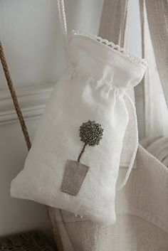 love the flower on the linen bag, maybe for lavendar sachet.....