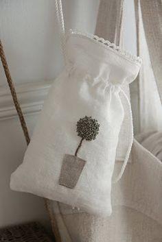 love the flower on the linen bag, maybe for lavendar sachet.....
