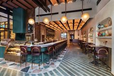 Moxy Chelsea by Stonehill Taylor, Yabu Pushelberg, and Rockwell Group - Dwell Chelsea New York, Chelsea Hotel, Flatiron Building, Rockwell Group, Yabu Pushelberg, Terrazzo Flooring, Bar Seating, Design Studio, Cafe Design