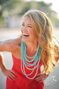 Teal necklaces w/ coral strapless dress