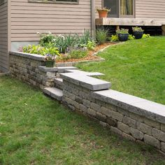 DIY Retaining Wall -  A retaining wall tames a problem slope, giving you more room to work and play outside. Do-it-yourselfers with a little experience can usually complete walls up to 4x12 feet in a weekend.