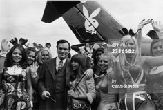 29th July, 1970. Hugh Hefner, American editor, publisher and founder of Playboy magazine, and his girlfriend Barbi Benton are welcomed by 'Bunny Girls' from the London Playboy Club,