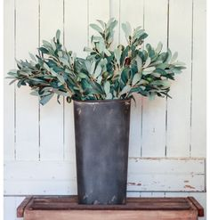 "This listing is for a SET of THREE faux olive branches with leaves beautifully crafted from fabric. Each stem is 17"" tall and features multiple olives in shades of dark brown and green. These branches"
