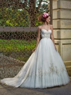 Beautiful Casablanca couture wedding dress with floral headpiece
