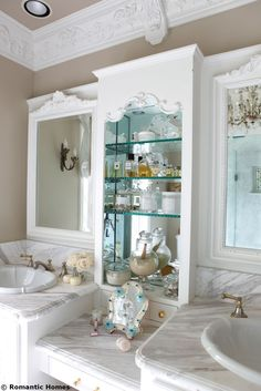 love the molding and mirrored cabinet