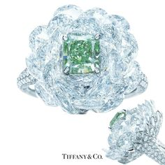 Tiffany & Co. Ring. A rare green diamond emerges from tiered white diamonds like a cool summer breeze. Radiant-cut Fancy Vivid Green diamond, carat weight 1.21, clarity grade SI2; rose-cut white diamonds, carat total weight 9.20; round brilliant white diamonds, carat total weight 1.25. Image: Tiffany & Co.