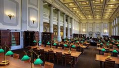 The renovated-and-restored Library Reading Room, with replicated brass table lamps both providing bright lighting and outlets to power patrons' laptops
