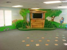 Worlds of Wow - a small stage and theming around the room make this children's large group room fun for Brentwood Oaks Church.