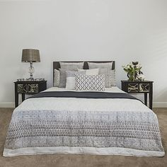 Embellish your modern bedroom with the divine patterns across the cosy cotton, quilted Pani Comforter Set from Rinas.
