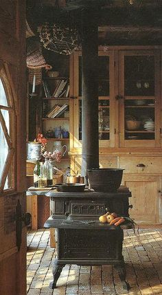 Love this wood stove and kitchen