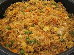Easy fried rice, better than takeout! 3 cups cooked rice (day old or leftover rice works best!), 3 tbs sesame oil, 1 cup frozen peas and carrots-thawed, 1 small chopped onion, 2 tsp minced garlic, 2 slightly beaten eggs, 1/4 cup soy sauce. On medium-high heat, fry peas/carrots, onion and garlic until tender. Lower heat to medium-low, push mixture to side and add eggs to fry until scrambled. Add rice and soy sauce. Stir fry until thoroughly heated. Try adding green onion, chicken and/or beef.