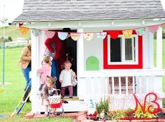 This playhouse is all gussied up for a housewarming party. Simple touches like a red window and green mailbox add to the adorableness. Perfect for my grandbabies:) Outside Playhouse, Build A Playhouse, Playhouse Outdoor, Playhouse Ideas, Garden Playhouse, Outdoor Playground, Cubby Houses, Play Houses, Wendy House