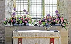 Church flowers on a budget.  Use flowers that are in season and buy from local florists.