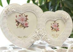 China OEM Resin Photo Frame Double Heart Manufacturer http://www.funnytoysgift.com/disney-licensed-resin-factory-Resin-photo-frame-D-1671.html